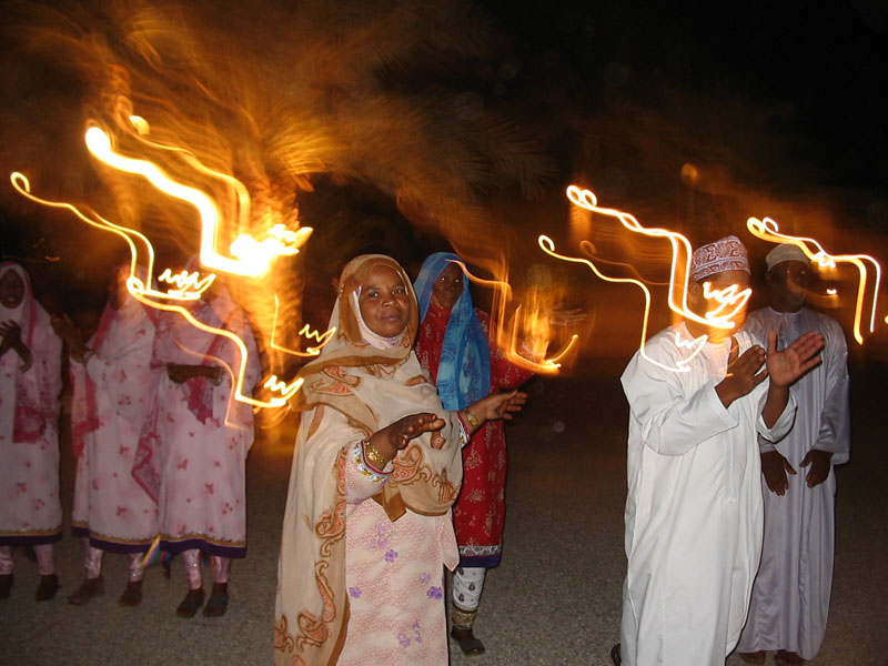 Singers performing at a nighttime feast in Muscat, Oman